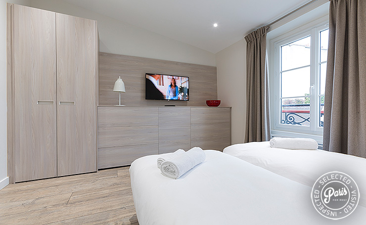 Flat screen TV in bedroom at Marais Sicile, Paris apartment rental, Marais