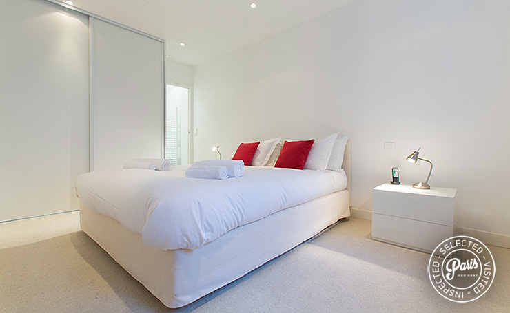 Queen-size bed in master bedroom at St Germain Grenelle, Paris apartment rental, Saint Germain