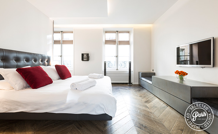 Bedroom with flat screen TV  at Elysee Garden, apartment rental in Paris, Champs-Elysées