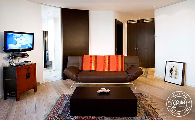 leather sofa bed at Four, apartment for rent in Paris, Saint Germain