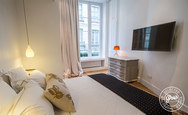 Flat screen TV in bedroom at St Germain Charm, apartment rental in Paris, Saint Germain