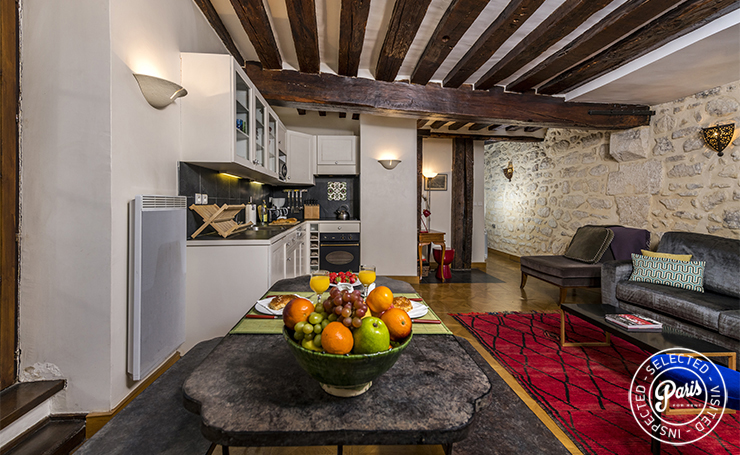 Dining room with stone wall at Vertus, vacation rental in Paris, Marais