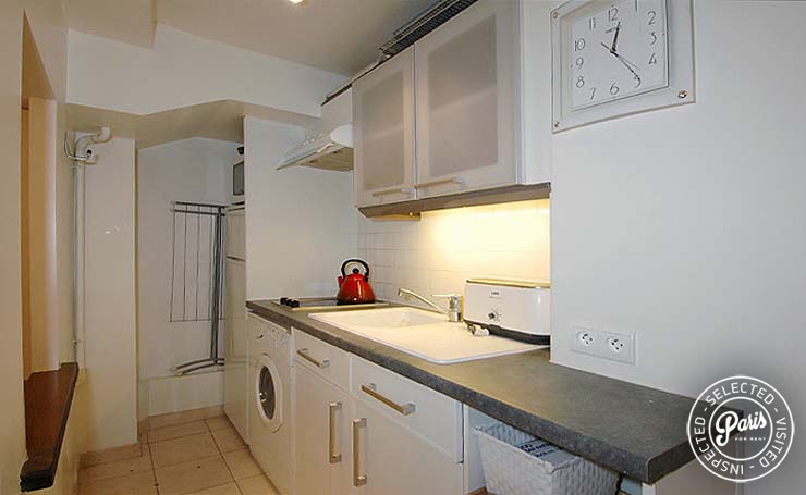 Kitchen with washer dryer at Place Bourg, Paris apartment rental, Marais