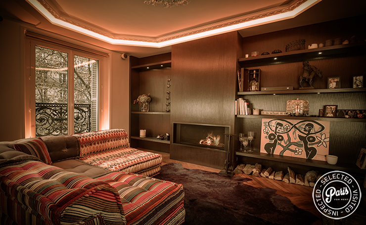 Large corner sofa and fireplace at St Germain Chic, apartment rental in Paris, Saint Germain