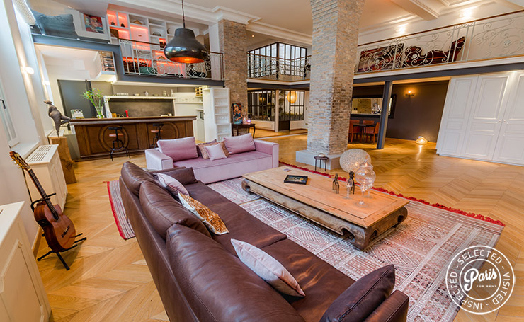 Lounge with leather sofa at Latin Quarter Loft, Paris vacation rental, Latin Quarter