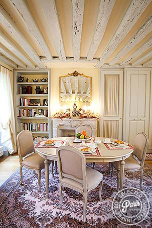 Dining area with exposed beams at Marais Elegance, apartment for rent in Paris, Marais