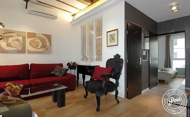 Sofa bed and armchair at Bourg Suite, vacation rental in Paris, Marais