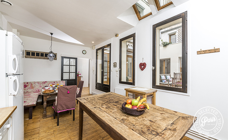 kitchen and breakfast nook in 3 bedroom duplex home in Paris apartment in the heart of Paris Marais district
