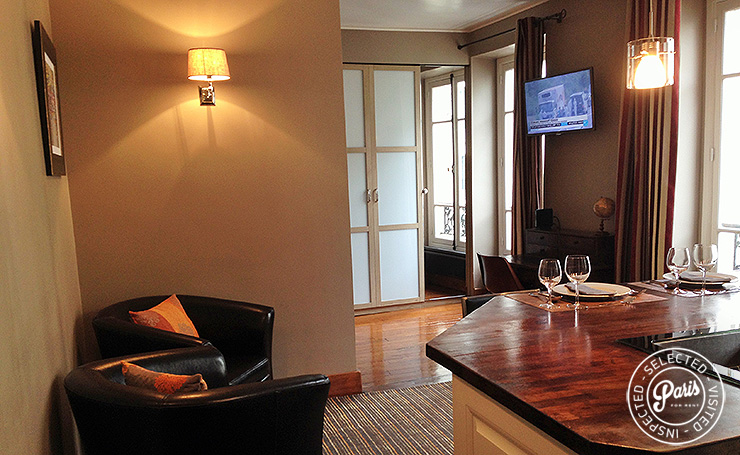 Lounge area with flat screen TV at Rue Cler, Paris flat rental, Eiffel Tower