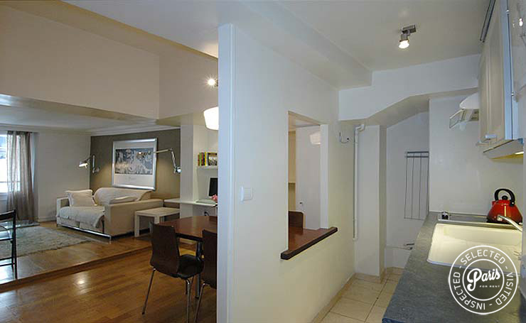 Open kitchen and living room at Place Bourg, Paris flat rental, Marais