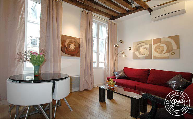 Living and dining room at Bourg Suite, apartment for rent in Paris, Marais
