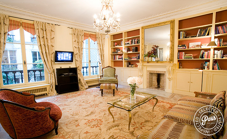 Main salon with decorative fireplace at Rive Gauche, apartment for rent in Paris, Saint Germain