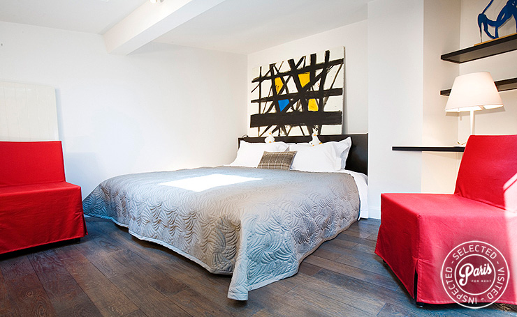 Contemporary red chairs in bedroom at St Germain Eden, Paris vacation rental, Saint Germain