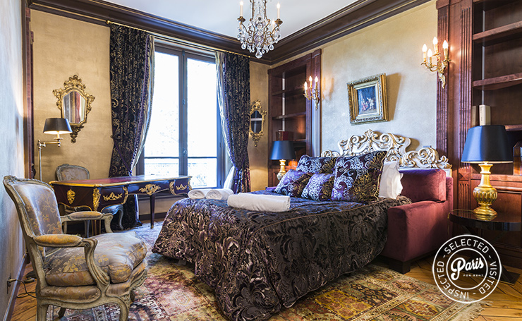 King size bed in master bedroom at Marais Penthouse, apartment for rent in Paris, Marais
