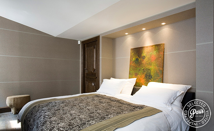 Queen-size bed in master bedroom at St Germain Eden, Paris apartment rental, Saint Germain