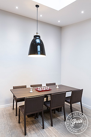 Designer dining table at Marais Sicile, Paris apartment rental, Marais